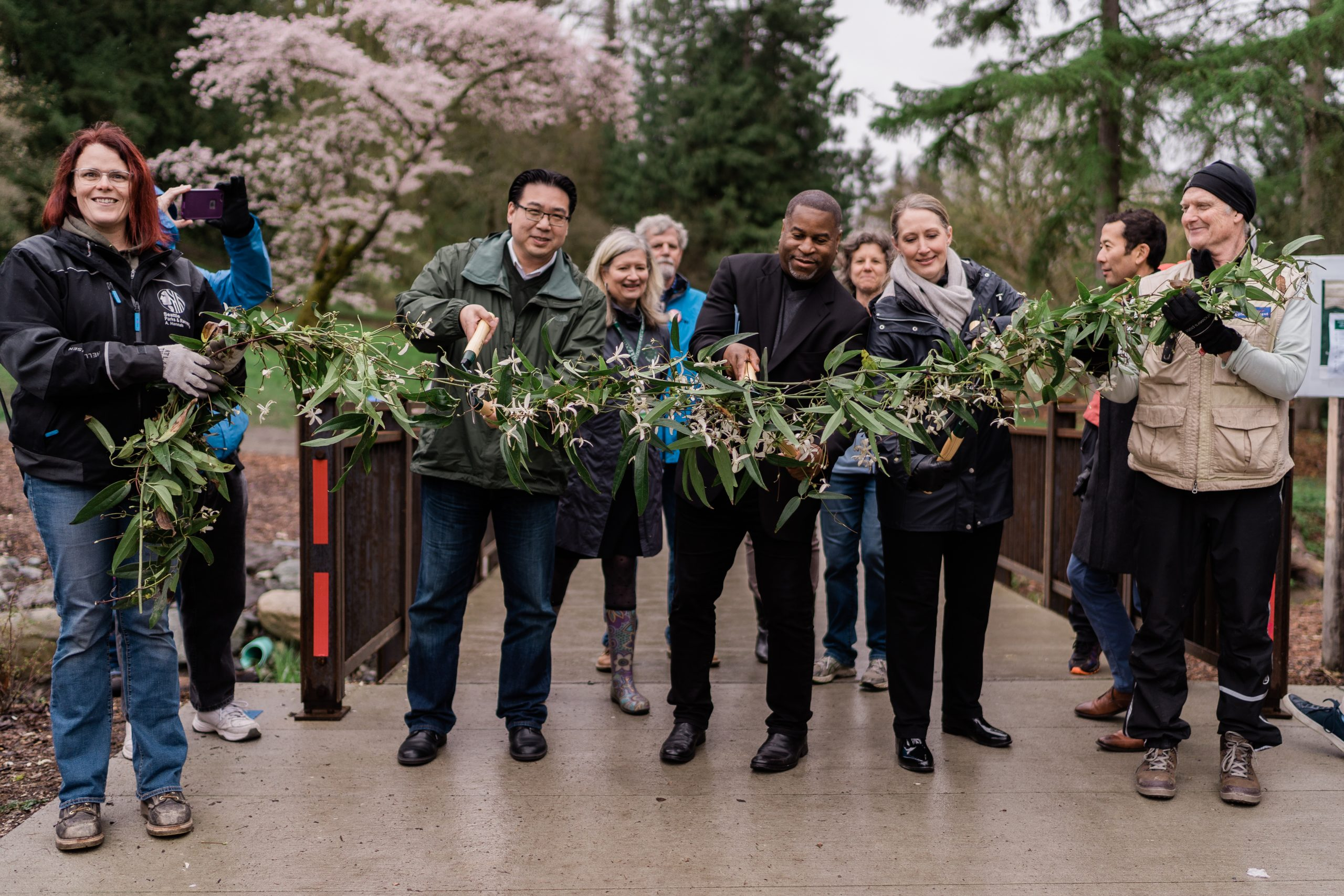 Arboretum Partners do a vine cutting ceremony to open the Arboretum's new Loop Trail