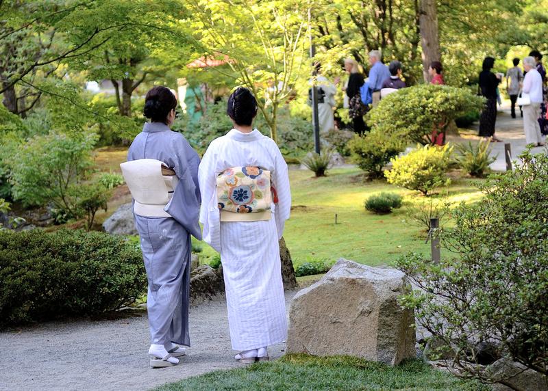 two women in kimonos at a garden party
